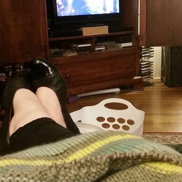 "Here's my day in a nutshell: knitting, laundry and a new show on Netflix, ""The Indian Detective."" Good so far!"